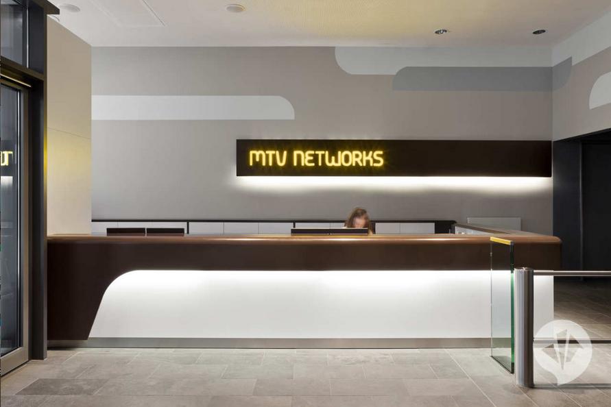 Mtv headquarters creating work life balance through for Modern office reception backdrop design